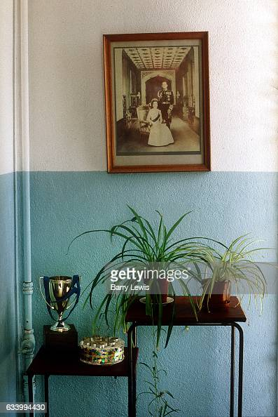Queen Elizabeth and Prince Phillip's photograph in the entrance to two Boats School the only school on the island providing education to all resident...