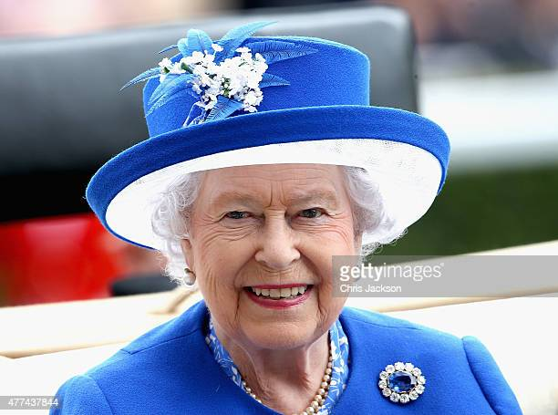 Queen Elizabeth arrives in the royal carriage for day 2 of Royal Ascot at Ascot Racecourse on June 16 2015 in Ascot England