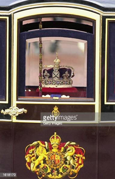 Queen Elizabeth' crown and scepter is driven in a coach down The Mall in London on November13 2002 as part of the opening of Parliament