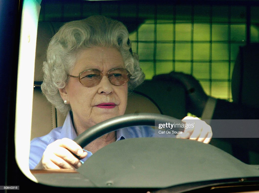 Queen Elizabeth drives around the grounds of Windsor as she attends the third day of the Royal Windsor Horse Show at Home Park on May 15, 2004 in Windsor, England.