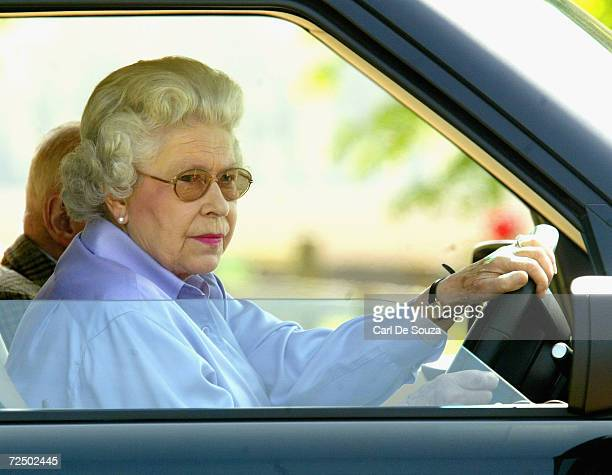 Queen Elizabeth drives around the grounds of Windsor as she attends the third day of the Royal Windsor Horse Show at Home Park on May 15 2004 in...