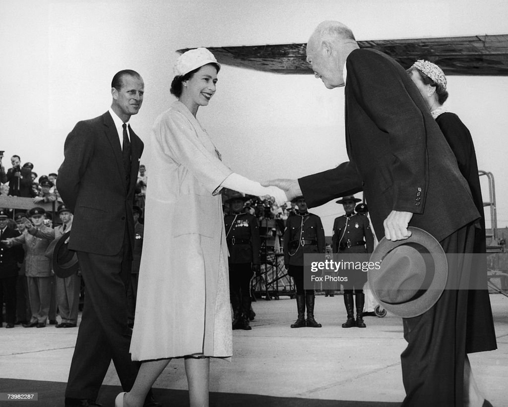 Queen Elizabeth greets US President Dwight D. Eisenhower (1890 - 1969) before they take part in the opening ceremony of the St. Lawrence Seaway at Lambert Lock, Montreal, 26th June 1959. On the left is Prince Philip, Duke of Edinburgh.