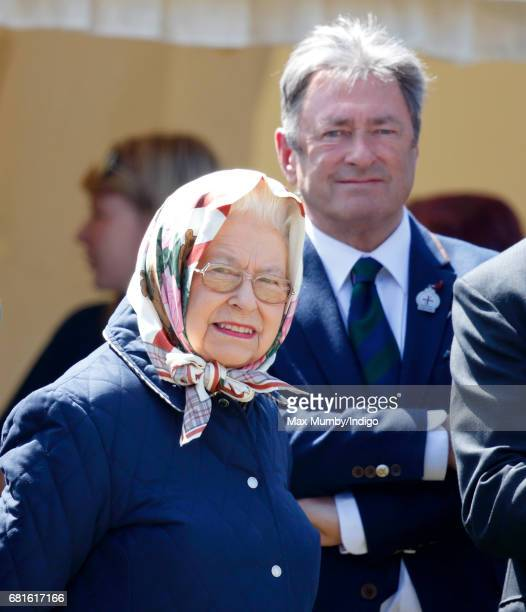 Queen Elizabeth II accompanied by Alan Titchmarsh watches her horse 'Tower Bridge' compete in The Cuddy Heavyweight Hunter Class on day 1 of the...