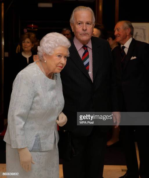 Queen Elizabeth II accompanied by Col Ian Paterson arrives at a reception to celebrate the Women's Royal Naval Service 100 project at The Army and...