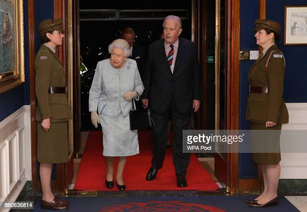 Queen Elizabeth II accompanied by Col Ian Paterson walk past two women dressed as World War II era First Aid Nursing Yeomanry as the queen arrives at...