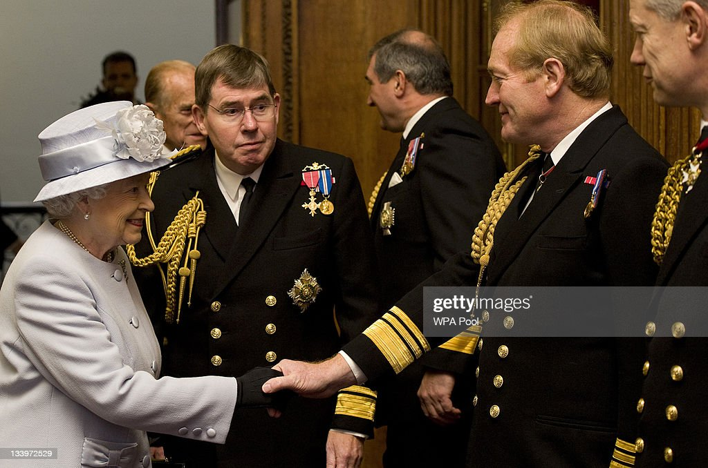 Queen <a gi-track='captionPersonalityLinkClicked' href=/galleries/search?phrase=Elizabeth+II&family=editorial&specificpeople=67226 ng-click='$event.stopPropagation()'>Elizabeth II</a> accompanied by First Sea Lord, Admiral Sir Mark Stanhope (L), meets military members of the Navy Board during a visit to the Admiralty Board and Admiralty House on 23 November, 2011 in London, England. The Duke of Edinburgh was inaugurated as Lord High Admiral as well as formally receiving the Letters Patent, followed by a lunch given by the First Sea Lord at Admiralty House.