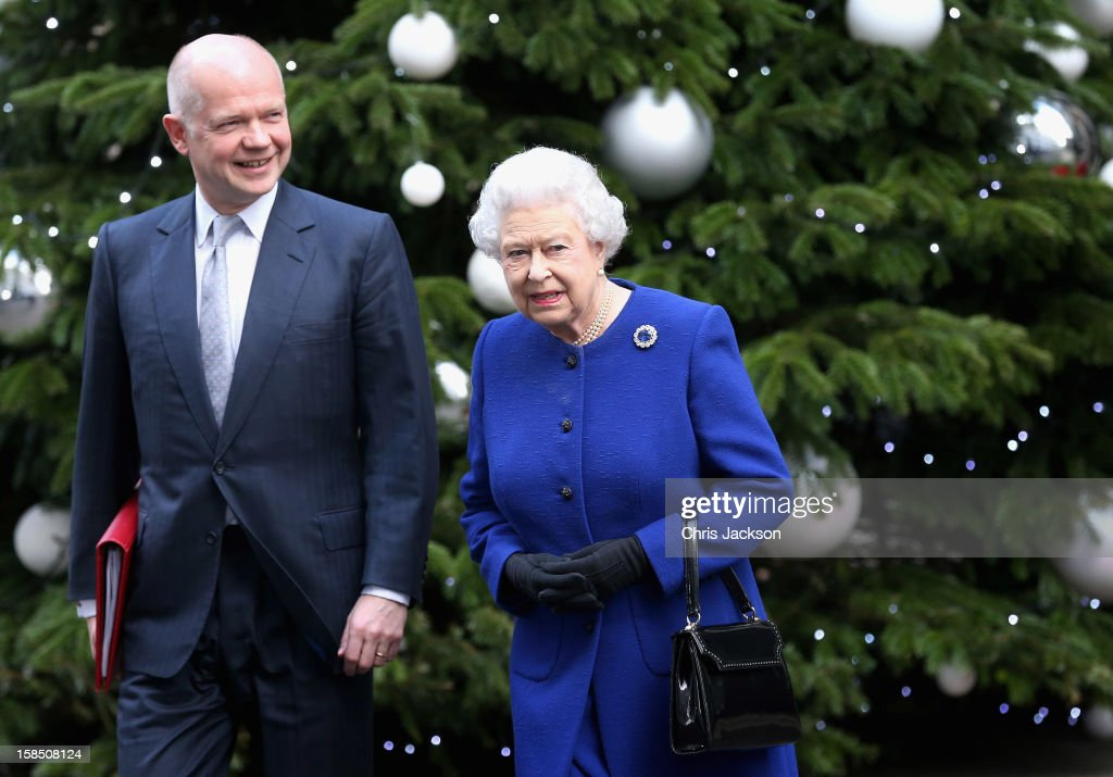 Queen <a gi-track='captionPersonalityLinkClicked' href=/galleries/search?phrase=Elizabeth+II&family=editorial&specificpeople=67226 ng-click='$event.stopPropagation()'>Elizabeth II</a>, accompanied by Foreign Secretary <a gi-track='captionPersonalityLinkClicked' href=/galleries/search?phrase=William+Hague&family=editorial&specificpeople=206295 ng-click='$event.stopPropagation()'>William Hague</a>, leaves Number 10 Downing Street after attending the Government's weekly Cabinet meeting on December 18, 2012 in London, England.