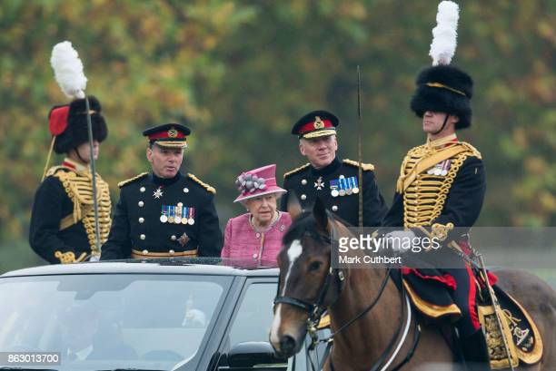 Queen Elizabeth II accompanied by Lieutenant General Andrew Gregory and Major General Matthew Sykes review The King's Troop Royal Horse Artillery on...