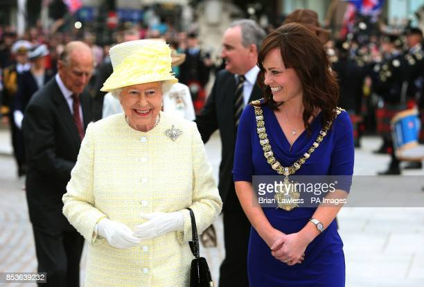 Queen Elizabeth II accompanied by Lord Mayor of Belfast SDLP Councillor Nichola Mallon on arrival at City Hall Belfast during a three day Royal visit...
