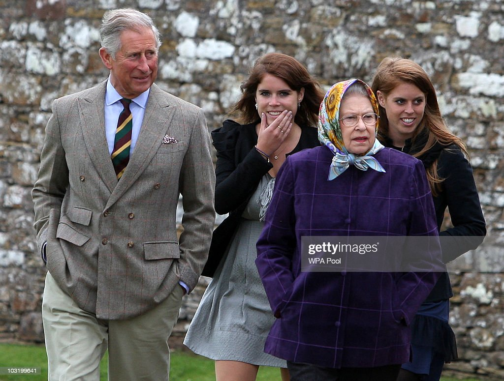 Queen Elizabeth II (R) accompanied by Prince Charles, Prince of Wales (L), Princess Eugenie, (C), and Princess Beatrice and the rest of the Royal family arrive at the Castle of Mey after disembarking the Hebridean Princess boat after a private family holiday around the Western Isles of Scotland, on August 02, 2010 in Scrabster, Scotland.