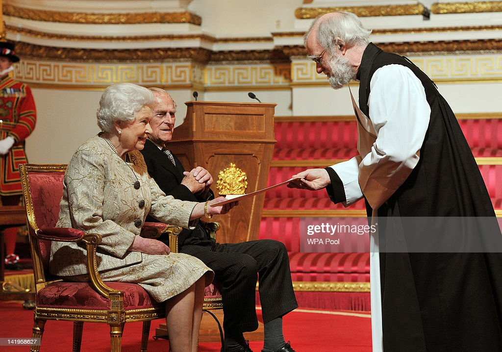Queen Elizabeth II accompanied by <a gi-track='captionPersonalityLinkClicked' href=/galleries/search?phrase=Prince+Philip&family=editorial&specificpeople=92394 ng-click='$event.stopPropagation()'>Prince Philip</a>, Duke of Edinburgh receives a copy of the loyal address from the Archbishop of Canterbury Dr <a gi-track='captionPersonalityLinkClicked' href=/galleries/search?phrase=Rowan+Williams&family=editorial&specificpeople=239468 ng-click='$event.stopPropagation()'>Rowan Williams</a> during a presentation of loyal addresses by the privileged bodies at a ceremony to mark the Queen's Diamond Jubilee at Buckingham Palace on March 27, 2012 in London, England.