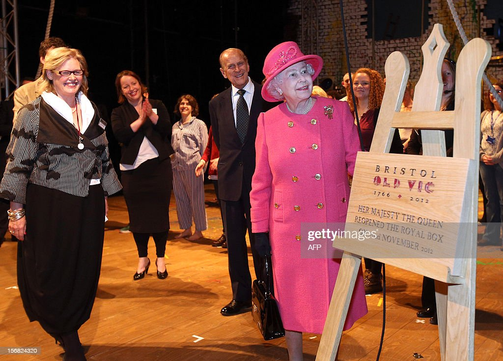 Queen Elizabeth II, accompanied by Prince Philip, Duke of Edinburgh, unveils a plaque to commemorate her visit and the completion of the work at the recently refurbished Bristol Old Vic Theatre as part of her Jubilee tour on November 22, 2012 in Bristol, England.