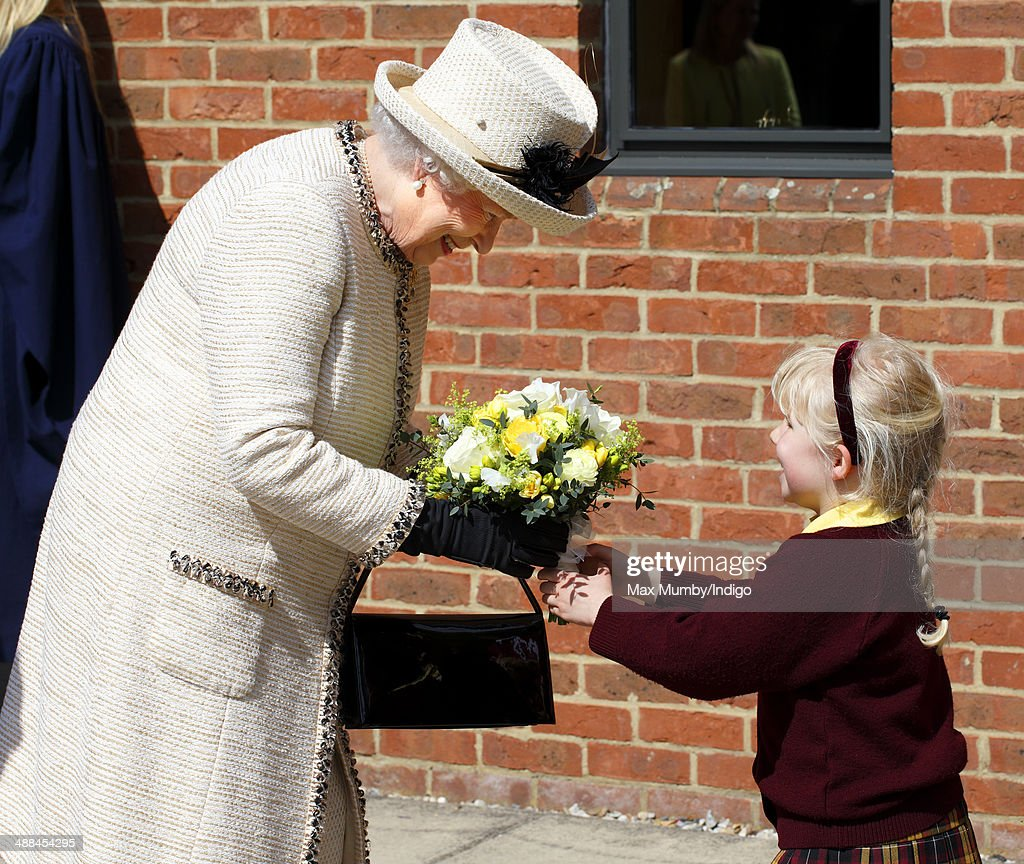 Queen <a gi-track='captionPersonalityLinkClicked' href=/galleries/search?phrase=Elizabeth+II&family=editorial&specificpeople=67226 ng-click='$event.stopPropagation()'>Elizabeth II</a> accompanied by Prince Philip, Duke of Edinburgh receives a posy of flowers as she visits Felsted School during day of engagements in Essex on May 6, 2014 in Felsted, England.