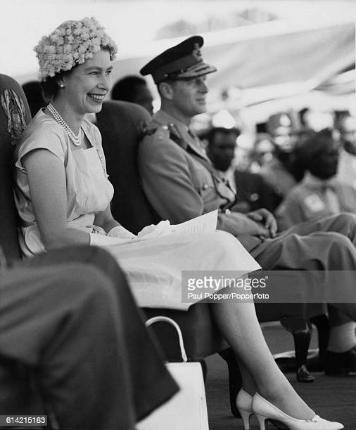 Queen Elizabeth II accompanied by Prince Philip Duke of Edinburgh watches a display at a durbar festival in Kumasi South Ghana during the royal tour...