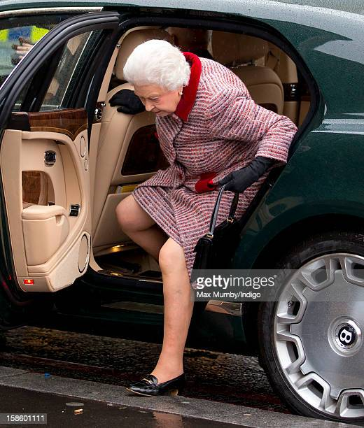 Queen Elizabeth II accompanied by Prince Philip Duke of Edinburgh steps out of her Bentley car as she arrives at King's Cross Railway Station to take...