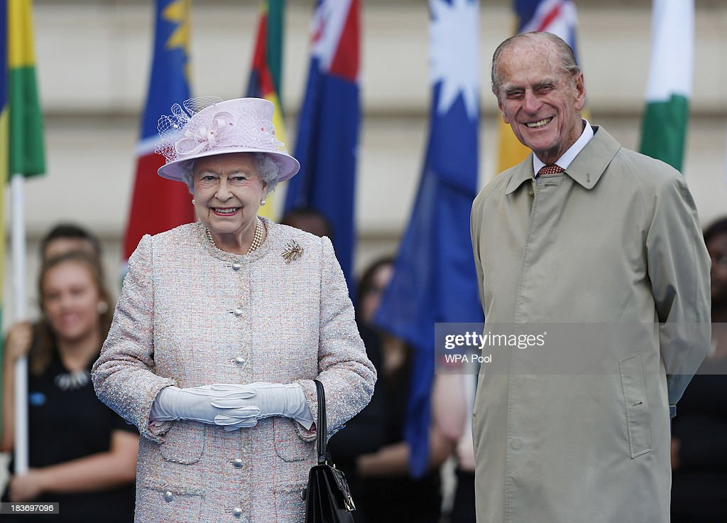 Queen <a gi-track='captionPersonalityLinkClicked' href=/galleries/search?phrase=Elizabeth+II&family=editorial&specificpeople=67226 ng-click='$event.stopPropagation()'>Elizabeth II</a> accompanied by <a gi-track='captionPersonalityLinkClicked' href=/galleries/search?phrase=Prince+Philip&family=editorial&specificpeople=92394 ng-click='$event.stopPropagation()'>Prince Philip</a>, Duke of Edinburgh attend the 2014 Glasgow Commonwealth Games Baton relay launch ceremony at Buckingham Palace on October 9, 2013 in London, England. After presenting the baton to Queen <a gi-track='captionPersonalityLinkClicked' href=/galleries/search?phrase=Elizabeth+II&family=editorial&specificpeople=67226 ng-click='$event.stopPropagation()'>Elizabeth II</a>, the relay will continue it's journey visiting all 70 competing nations and territories ahead of the Commonwealth Games in Glasgow in 2014.