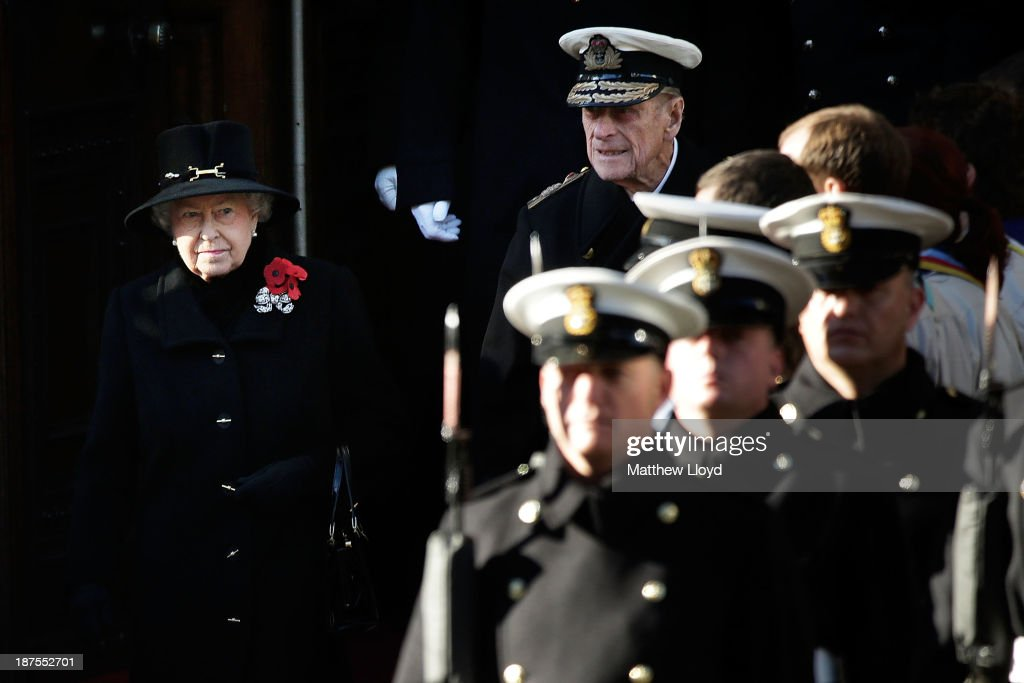 Queen <a gi-track='captionPersonalityLinkClicked' href=/galleries/search?phrase=Elizabeth+II&family=editorial&specificpeople=67226 ng-click='$event.stopPropagation()'>Elizabeth II</a>, accompanied by Prince Phillip, Duke of Edinburgh, leave the Foreign and Commonwealth Office shortly before 11am to take part in a wreath laying ceremony at the Cenotaph on Whitehall on November 10, 2013 in London, England. People across the UK gathered to pay tribute to service personnel who have died in the two World Wars and subsequent conflicts, as part of the annual Remembrance Sunday ceremonies.
