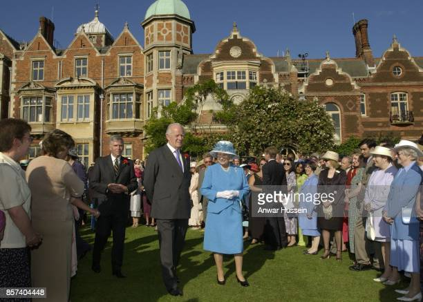 Queen Elizabeth II accompanied by Sir Timothy Colman of Colman's Mustard hosts a Garden Party at Sandringham House in Norfolk on July 18 2002 in...