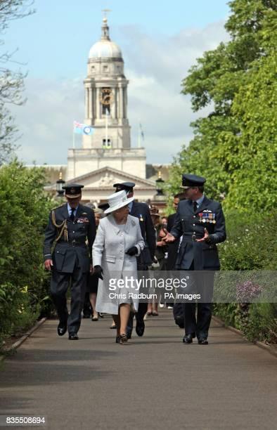 Queen Elizabeth II accompanied by Station Commander Captain Nigel Warmby and The Duke of Edinburgh at RAF Cranwell Lincolnshire