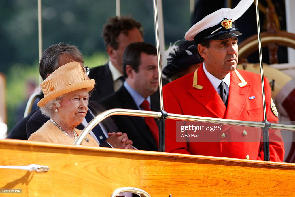 Queen Elizabeth II, accompanied by Swan Marker David Barker, watches the swan upping census from the steam launch 'Alaska' on the River Thames on July 20, 2009 near Windsor, England. During the ancient annual ceremony the Swan Marker leads a team of Swan Uppers on a five-day journey along the River Thames from Sunbury-on-Thames through Windsor to Abingdon counting, marking and checking the health of all unmarked swans.