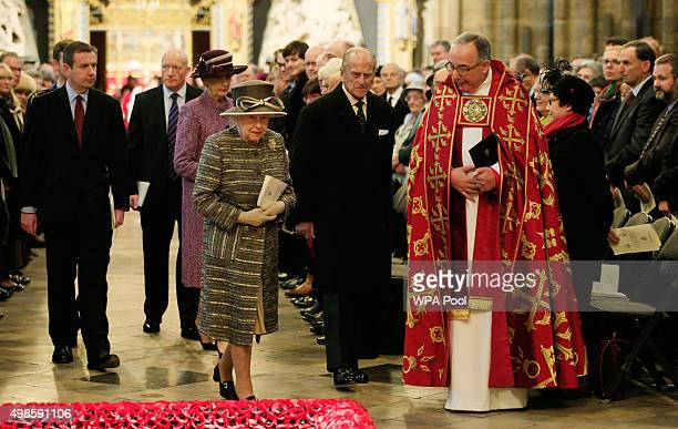 Queen Elizabeth II accompanied by the Dean of Westminster Reverend John Hall and the Prince Philip Duke of Edinburgh leave after a service for the...