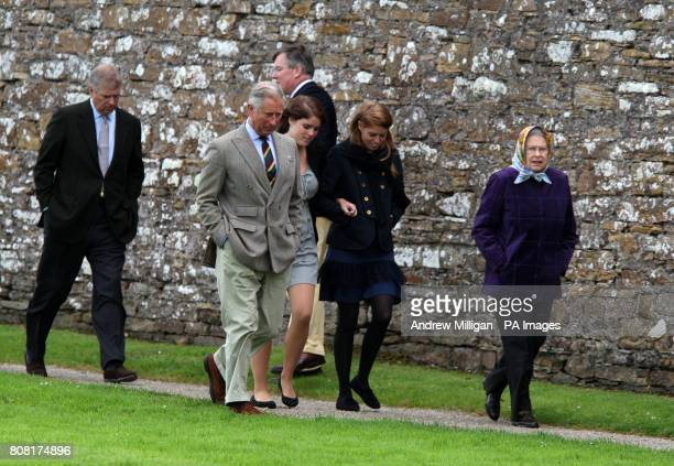 Queen Elizabeth II accompanied by The Duke of York the Prince of Wales Princess Eugenie and Princess Beatrice during a visit to the visitors centre...
