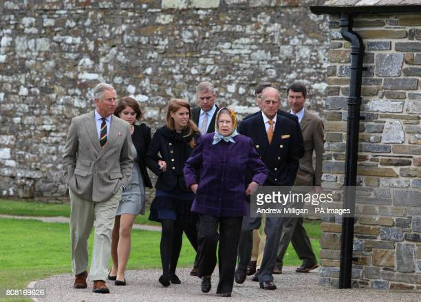 Queen Elizabeth II accompanied by the Prince of Wales Duke of Edinburgh Princess Eugenie Princess Beatrice their father the Duke of York and the...