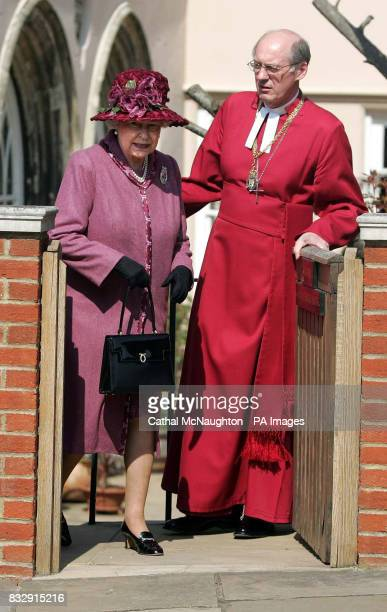 HRH Queen Elizabeth II accompanied by the Right Reverend David Conner Dean of Windsor leaves the Easter Sunday service in St George's Chapel Windsor...