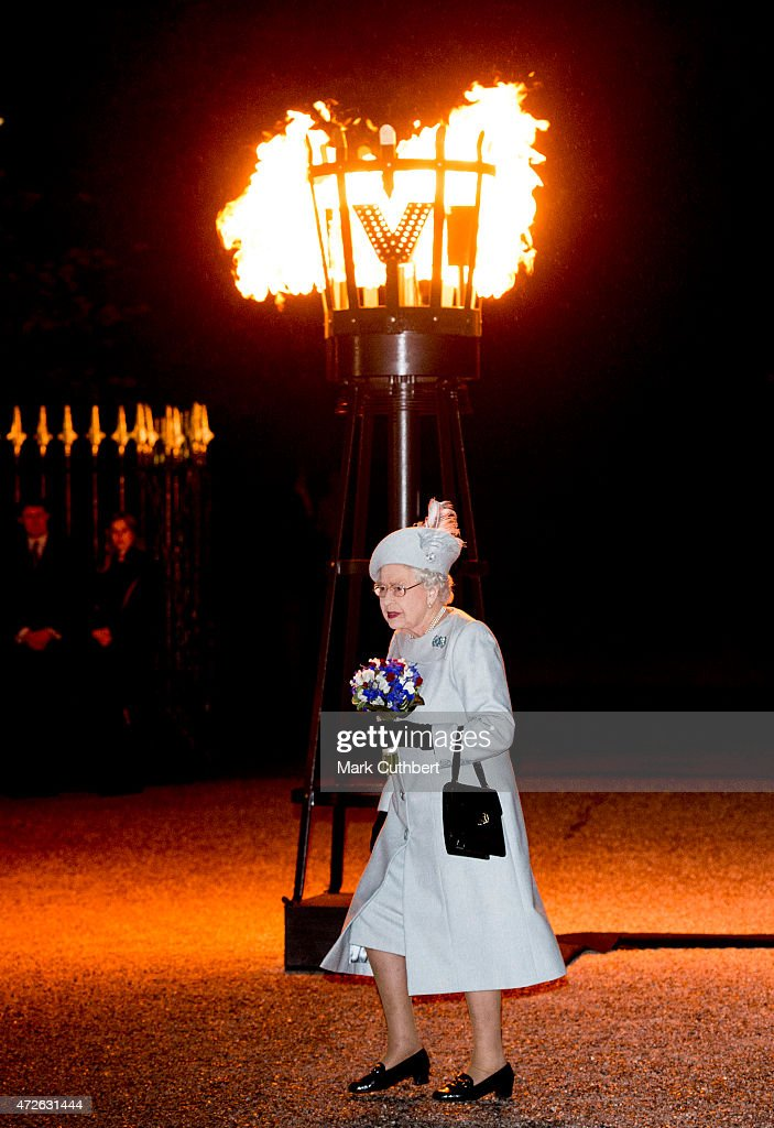 Queen Elizabeth II after lighting a beacon during three days of national commemorations to mark the 70th anniversary of VE Day on May 8, 2015 in Windsor, England. Great Britain now starts three days of national commemorations of street parties, concerts and other events across the country to remember the end of World War II in Europe.