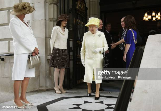 Queen Elizabeth II alongside Dame Mary Peters and Secretary of State for Northern Ireland Theresa Villiers on her departure from City Hall Belfast...