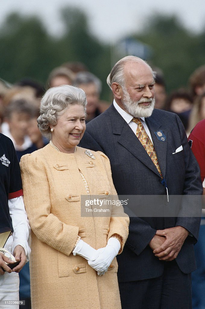 Queen Elizabeth II And Alfred Dunhill Attending A Polo Match Held At Home Park In