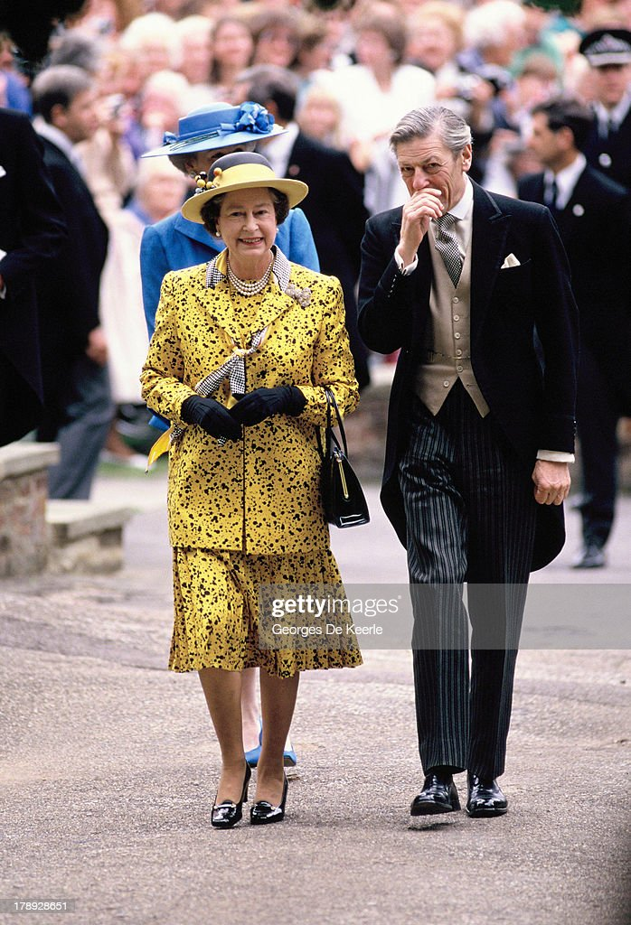 Queen <a gi-track='captionPersonalityLinkClicked' href=/galleries/search?phrase=Elizabeth+II&family=editorial&specificpeople=67226 ng-click='$event.stopPropagation()'>Elizabeth II</a> and <a gi-track='captionPersonalityLinkClicked' href=/galleries/search?phrase=Angus+Ogilvy&family=editorial&specificpeople=160704 ng-click='$event.stopPropagation()'>Angus Ogilvy</a> attend the wedding of their son James Ogilvy and Julia Rawlinson at St. Mary The Virgin Church on July 30, 1988 in Saffron Walden, England.