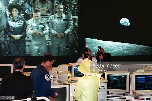 Queen Elizabeth II and British astronaut Mike Foale are photographed during live link with American and Russian astronauts at the NASA Goddard Space...