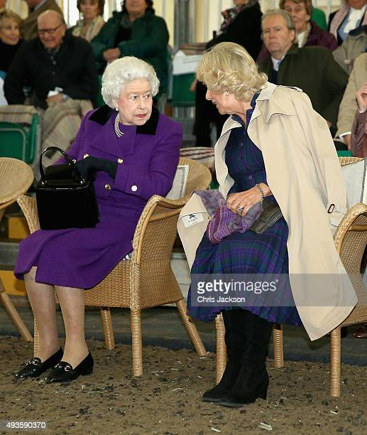 Queen Elizabeth II and Camilla Duchess of Cornwall attend a horse whispering demonstation by Brooke Global Ambassador Monty Roberts at the Royal Mews...