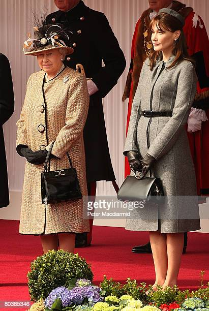 Queen Elizabeth II and Carla BruniSarkozy watch a ceremonial welcome at Windsor on March 26 2008 in England President Nicolas Sarkozy and Carla...
