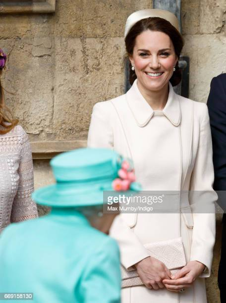 Queen Elizabeth II and Catherine Duchess of Cambridge attend the traditional Easter Sunday church service at St George's Chapel Windsor Castle on...