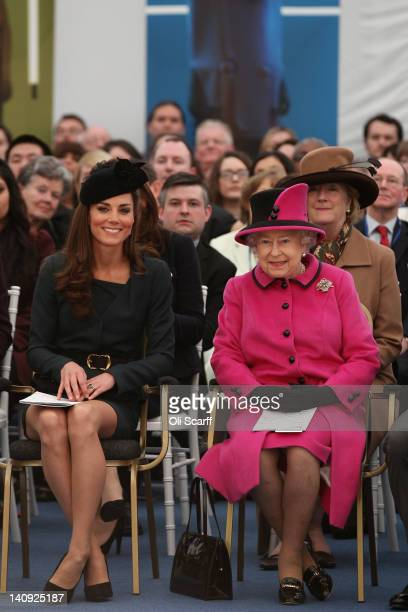Queen Elizabeth II and Catherine Duchess of Cambridge watch a fashion show at De Montfort University on March 8 2012 in Leicester England The royal...