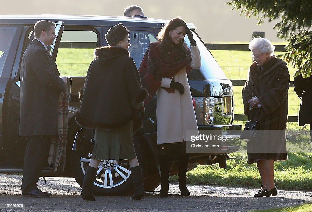 Queen <a gi-track='captionPersonalityLinkClicked' href=/galleries/search?phrase=Elizabeth+II&family=editorial&specificpeople=67226 ng-click='$event.stopPropagation()'>Elizabeth II</a> (R) and <a gi-track='captionPersonalityLinkClicked' href=/galleries/search?phrase=Catherine+-+Duchess+of+Cambridge&family=editorial&specificpeople=542588 ng-click='$event.stopPropagation()'>Catherine</a>, the Duchess of Cambridge arrive at the Christmas Day service at Sandringham on December 25, 2013 in King's Lynn, England.