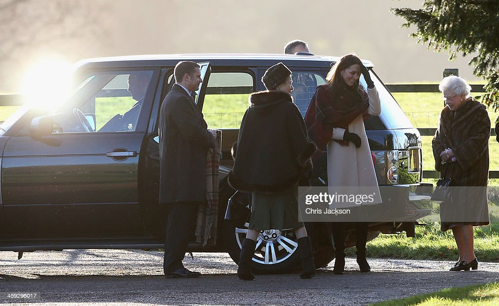 Queen Elizabeth II (R) and Catherine, the Duchess of Cambridge (2ndR) arrive at the Christmas Day service at Sandringham on December 25, 2013 in King's Lynn, England.