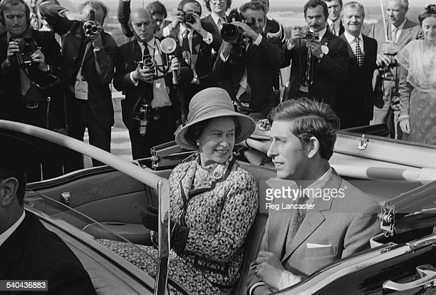 Queen Elizabeth II and Charles Prince of Wales travel in an open top car in Avignon during a state visit to France May 1972