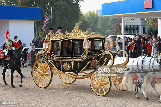Queen Elizabeth II and Chinese President Xi Jinping board the carriage during the Official Ceremonial Welcome for the Chinese State Visit on October...