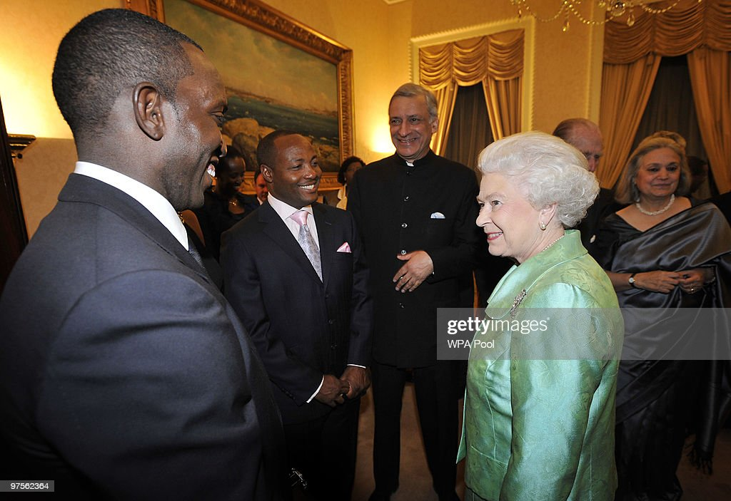Queen Elizabeth II and Commonwealth Secretary General Kamalesh Sharma (C) meet footballer <a gi-track='captionPersonalityLinkClicked' href=/galleries/search?phrase=Dwight+Yorke&family=editorial&specificpeople=206855 ng-click='$event.stopPropagation()'>Dwight Yorke</a> (L) and cricketer <a gi-track='captionPersonalityLinkClicked' href=/galleries/search?phrase=Brian+Lara&family=editorial&specificpeople=162724 ng-click='$event.stopPropagation()'>Brian Lara</a> (2nd L) at the Commonwealth Day Reception at Marlborough House on March 08, 2010 in London, England.