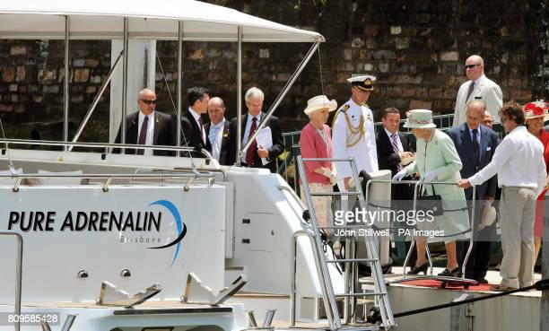 Queen Elizabeth II and Duke of Edinburgh board the motor cruiser Pure Adrenalin in Brisbane eastern Australia before taking a cruise along the...