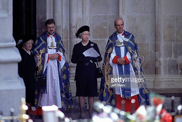 Queen Elizabeth II and Elizabeth Queen Mother at Funeral of Diana Princess of Wales Both women stand in between two priests at the steps of...
