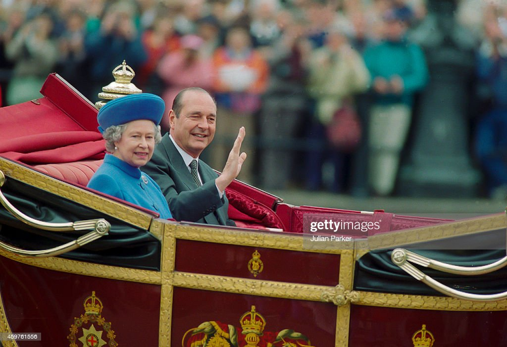 Queen Elizabeth II and French President Jacques Chirac take part in a procession in the Mall at the start of a French State Visit to the UK on May 14...
