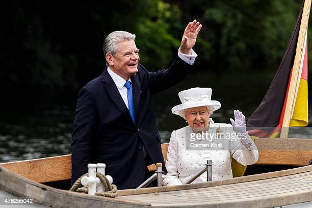 Queen Elizabeth II and German President Joachim Gauck ride a boat on the Spree River on the second of the royal couple's fourday visit to Germany on...