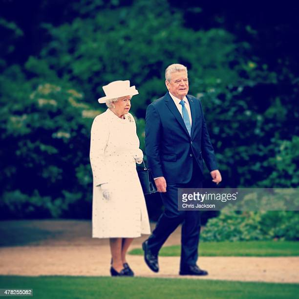 Queen Elizabeth II and German President Joachim Gauck walk in the gardens of the Schloss Bellevue Palace on the second day of a four day State Visit...