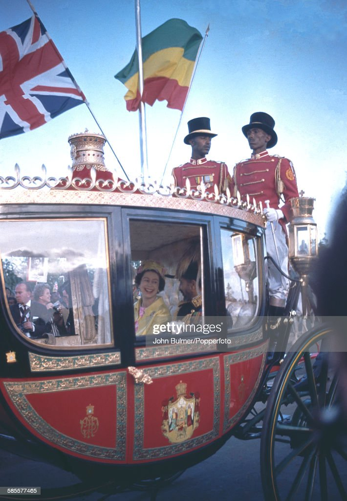 Queen Elizabeth II and Haile Selassie I (1892 - 1975), Emperor of Ethiopia, travelling in the royal coach during the Queen's state visit to Ethiopia, February 1965.