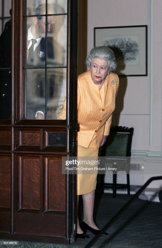 Queen Elizabeth II and her aide, Paul Whybrew (L), Peer Around A Door To Check The Limousine Awaiting For French President Jacques Chirac And His Wife As They Depart Windsor Castle After Their Visit For The Entente Cordiale Celebrations