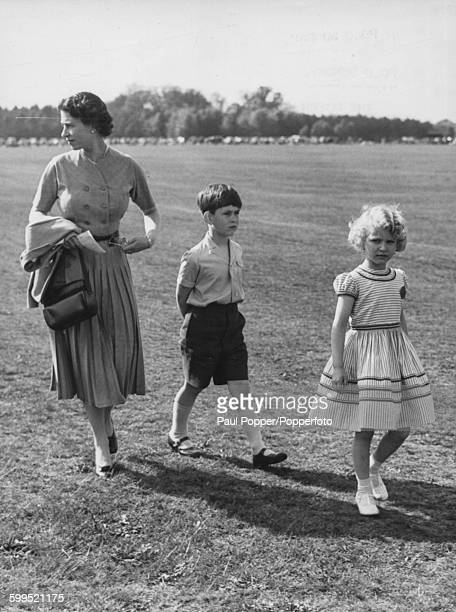 Queen Elizabeth II and her children Princess Anne and Prince Charles arrive to watch the Duke of Edinburgh play polo for the Household Brigade on...